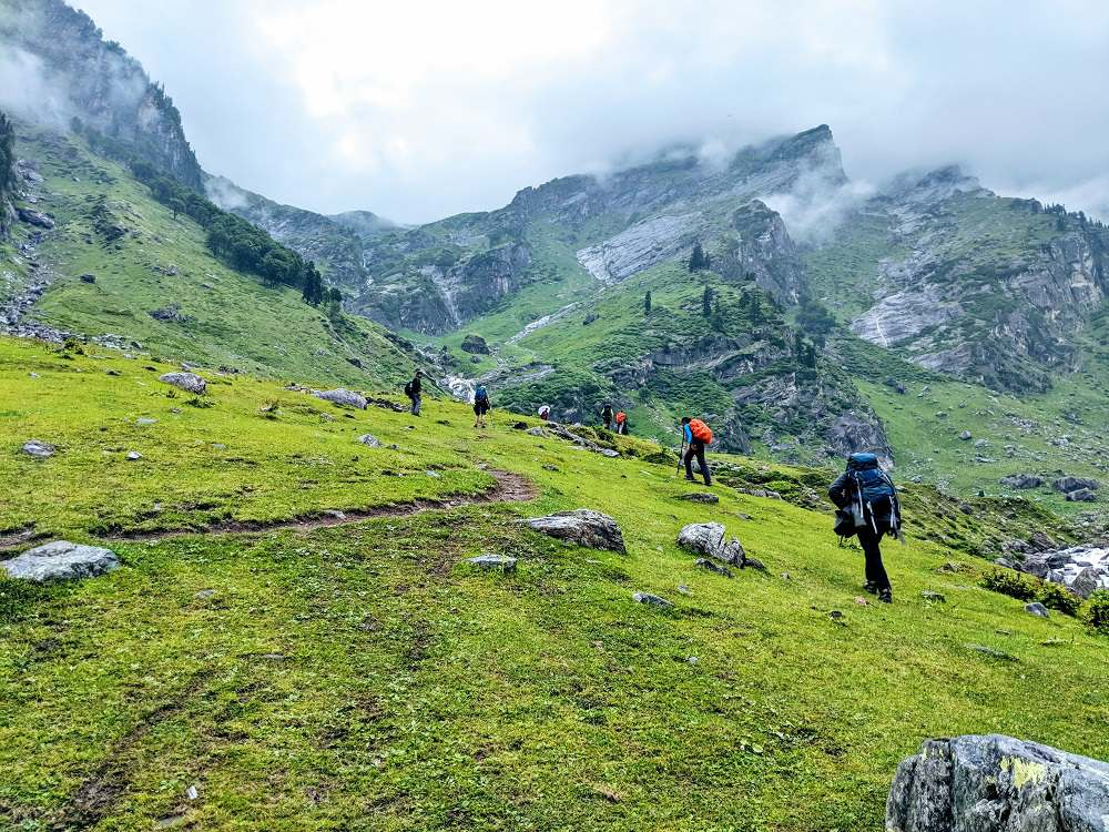Trekking through beautiful green meadows : HAMPTA PASS TREK