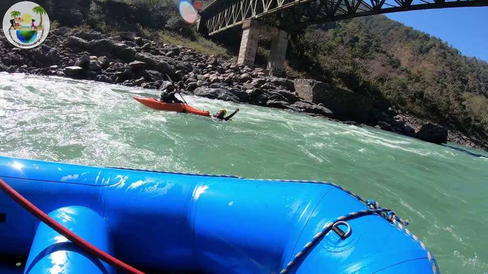 Rishikesh river rafting, jumping to water with kayak