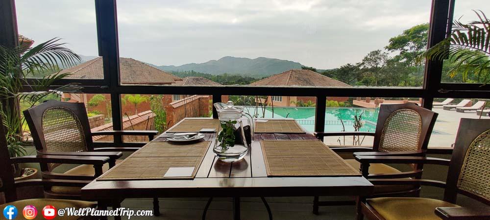 Pool and nature facing dining experience. Machaan resort, Sakleshpur