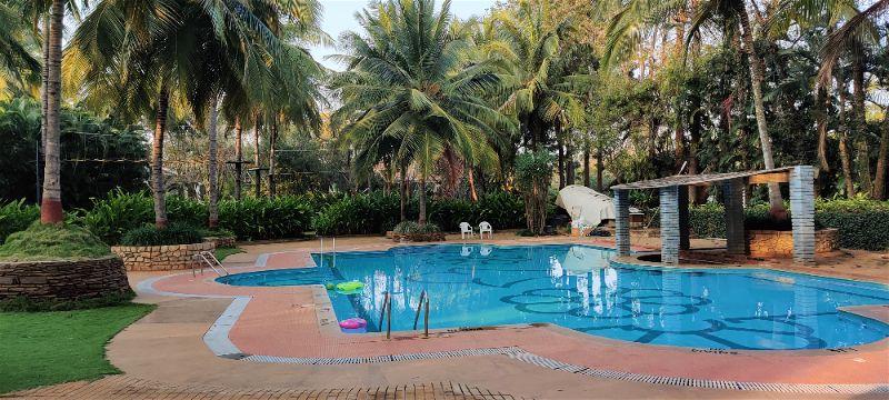Nice Swimming pool with covered trees, Windflower Prakruthi Resort & Spa, Bangalore